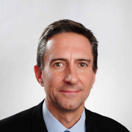 Dr. Adam K. Spector